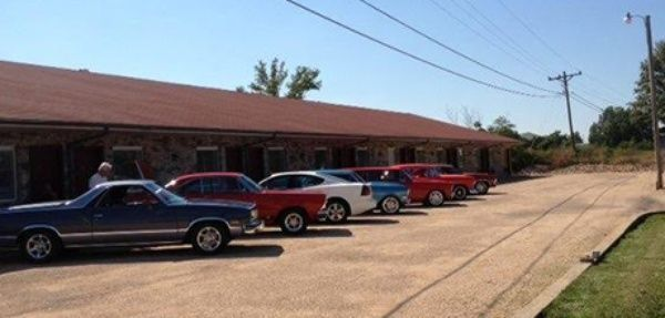 Exterior of motel with cars